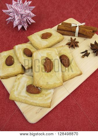 Gingerbread cookies with sugar icing and almonds