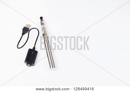 electronic nicotine inhalator on  background wood texture