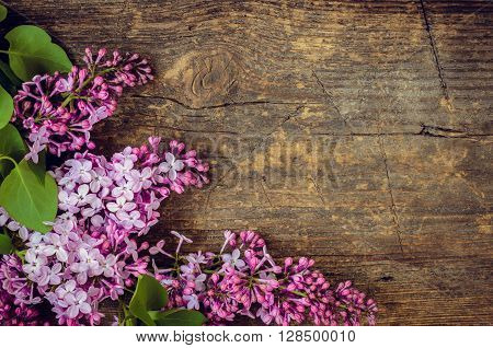 Beautiful lilac flowers on a wooden vintage board with place for text Happy Mothers Day. Toned picture. Mother's Day greetings card. Vintage still life. Mother's day. Mothers Day gift. Mothers Day.