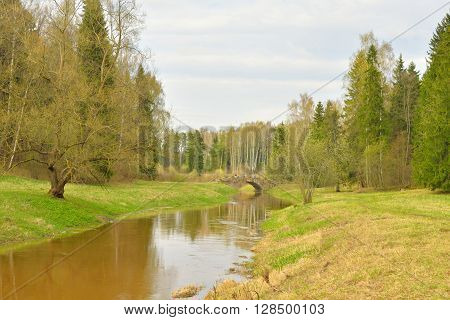 River Slavianka at spring cloud day on the outskirts of St. Petersburg Russia.