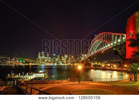 Long exposure fo SYDNEY AUSTRALIA - August, 8, 2016: View of Sydney Opera House and Harbour Bridged with red light celebrate chainese new year in Sydney Australia Over 10 millions tourists visit Sydney every year