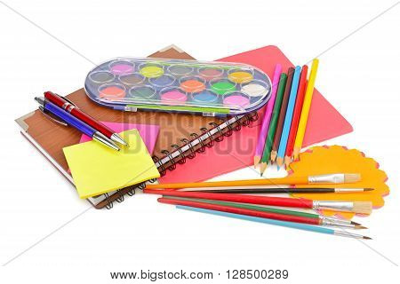 colored pencils paints notebooks and other stationery isolated on a white background