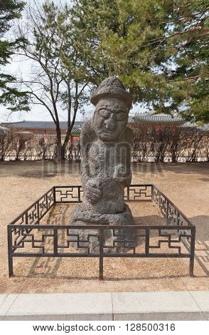 SEOUL SOUTH KOREA - MARCH 14 2016: Dolhareubang (Stone Grandfather) from Jeju Island in National Folk Museum of Korea in Seoul. Totem pole erected to drive off evil spirits