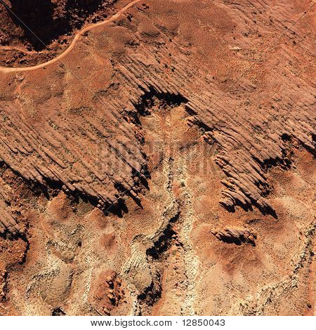 Bird's eye view of rock formations in a desert environment. Square format.