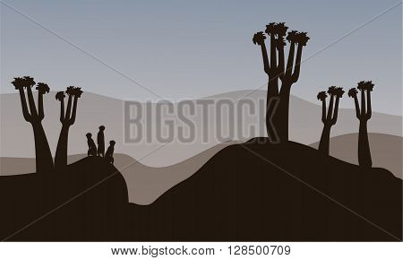 Meerkat silhouette in the hills with gray backgrounds