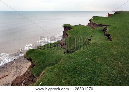 Clay cliffs on the east coast of Yorkshire, UK, eroding badly.