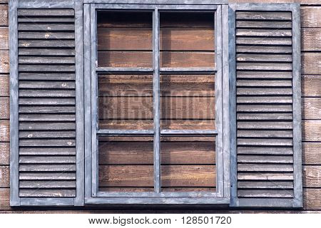 old wooden window with blinds closeup in a retro style and a blank space