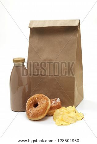 Isolated brown paper lunch bag with junk food