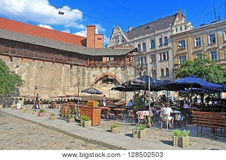 LVIV, UKRAINE - JULY 17, 2015: Open air restaurant located near the old city wall, Lviv, Ukraine. Lviv is a well-known city in Ukraine due to many historical sightseeing, many different restaurants with very delicious cuisine and cafes