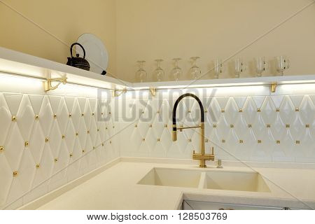 modern beautiful white kitchen with a sink and the mixer