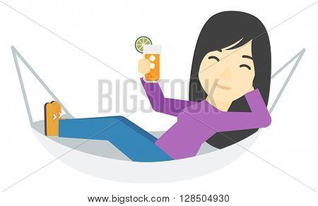 Woman lying in a hammock.
