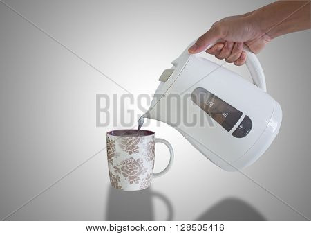 Pouring hot water into a mug for instant beverage