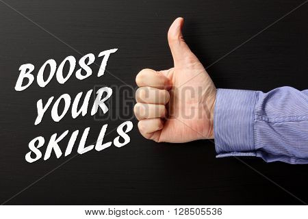 The words Boost Your Skills written on a blackboard next to a hand giving the thumbs up sign