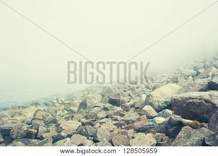 Landscape with fog over stones