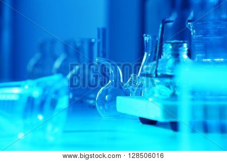 Test tubes and flasks on laboratory table closeup