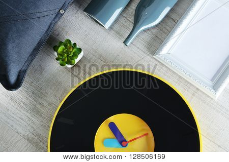 Little details of home interior on wooden background, top view