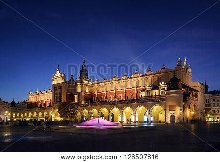 Cloth Hall Sukiennice building after sunset on Rynek square of Krakow city Poland