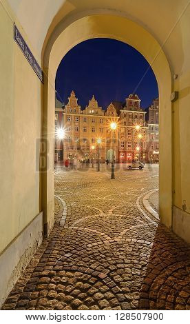 View from under the arch on market square after sunset in Wroclaw Poland