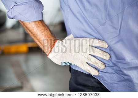 Mechanic Standing With Hand On Hip