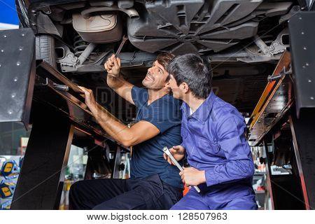 Mechanics Working Under Car