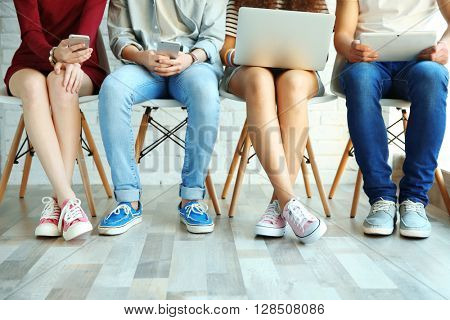 Group of people with digital devices  indoors