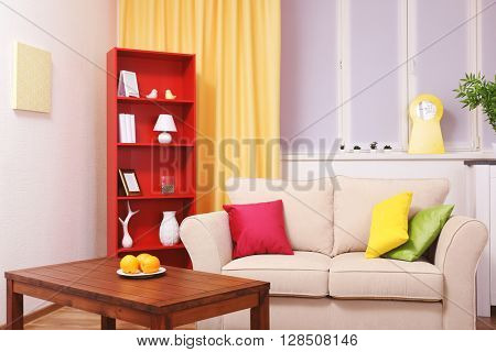 Modern interior design. Living room with sofa, table  and bookcase
