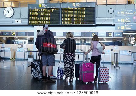 VALENCIA, SPAIN - MAY 3, 2016: Airline passengers checking in at the Valencia Airport. About 4.98 million passengers passed through the airport in 2015.