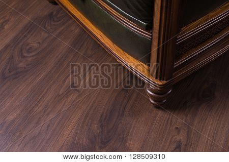 Green Leather Armchair On A Wooden Floor