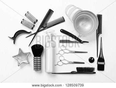 Barber set with tools, equipment and cosmetics on light background