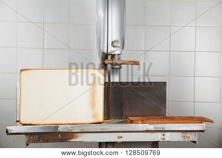 Bread Loaf On Cutting Machine In Bakery
