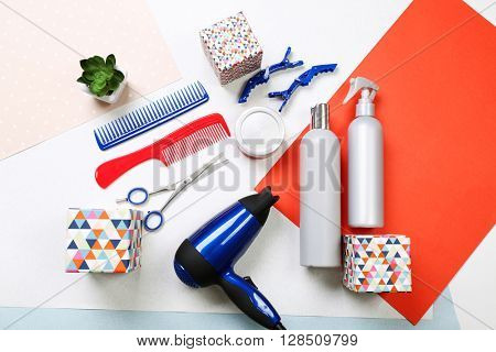 Barber set with tools, equipment, cosmetics and gift boxes on paper background