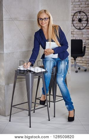 Young businesswoman working in temporary office.