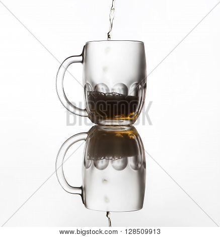 Iced beer mug on the glass surface