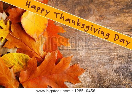 Autumn leaves background and text Happy Thanksgiving Day