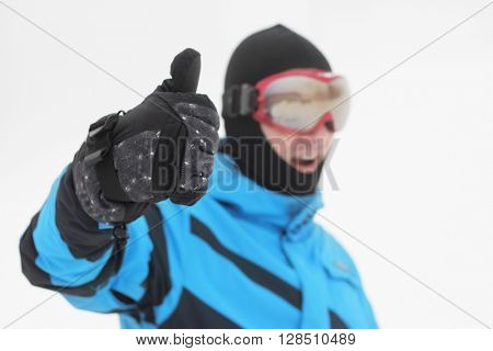 Man in snowboard goggles over snow background
