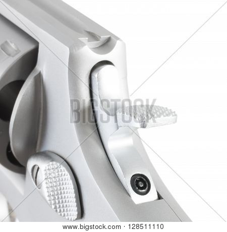 Steel revolver hammer that is down isolated on white