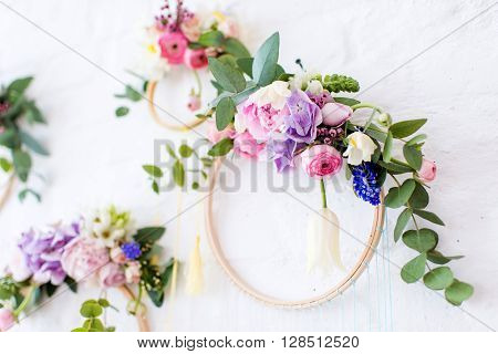 on a white brick wall wooden frame decorated with flowers