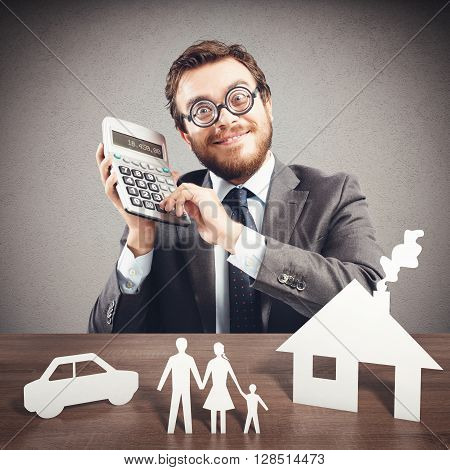 Man with calculator and family cardboard models