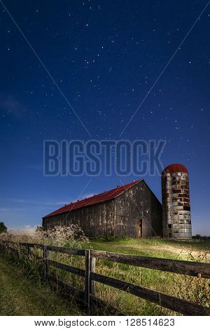 Old farm barn in moonlight