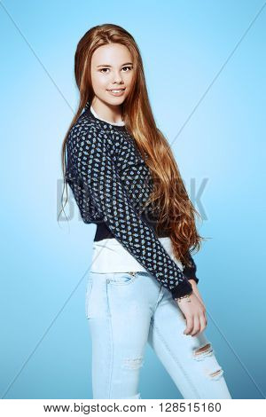 Happy teenager girl in casual clothes looking at camera and smiling. Modern teen generation. Youth fashion. Healthy hair, haircare.