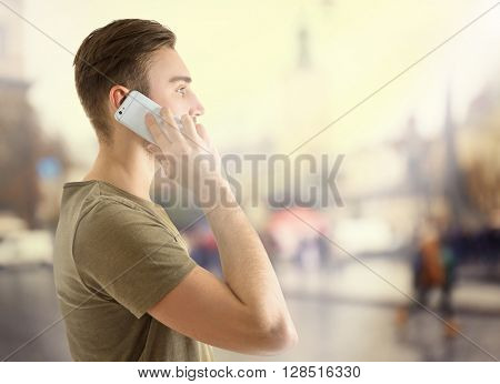 Young urban man using smart phone