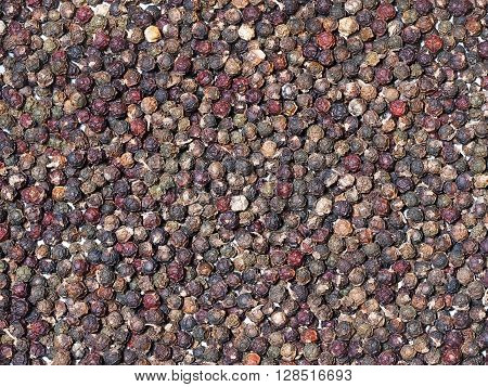 Black peppercorn background. Dried black pepper. Pepper seed.