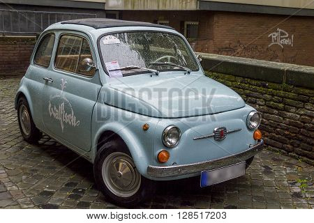 Cologne, Germany - May 16: This is the old mass production car Fiat Nouva 500 on cobbled parking May 16, 2013 in Cologne, Germany.
