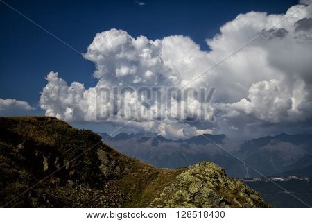Mountain landscape with cumulus clouds