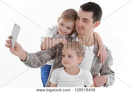 Dad making selfie with his sons isolated on white