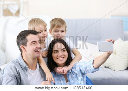 Happy family making selfie on couch background