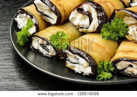 Appetizer - eggplant rolls stuffed with cheese creme, garlic and greens.