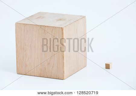Two wooden cubes of the different size. Subject shot in studio on a white background.