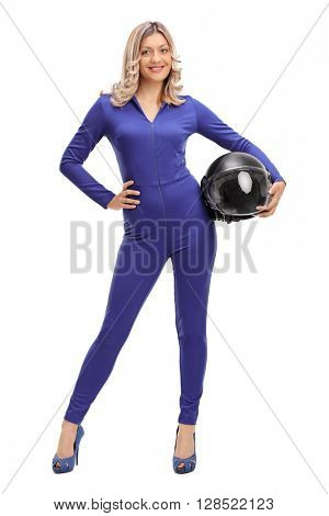 Full length portrait of a woman car racer in a blue racing suit holding a helmet isolated on white background