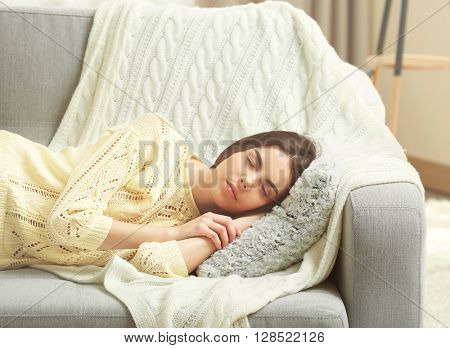 Young woman sleeping on the couch in living room